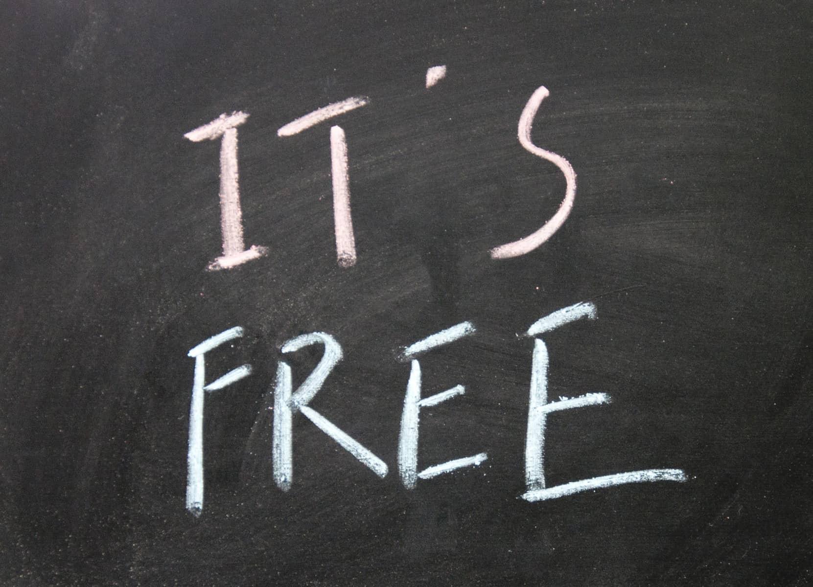 IT'S FREE written on black chalkboard