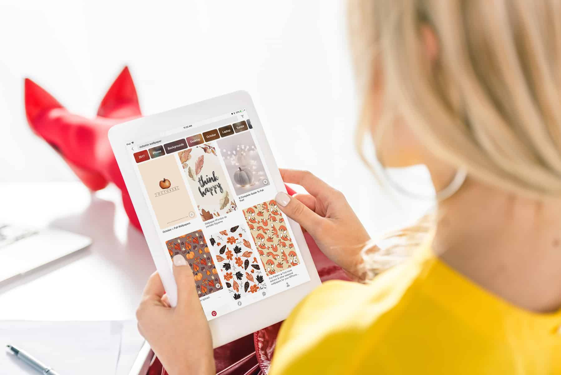 woman on tablet looking at pinterest
