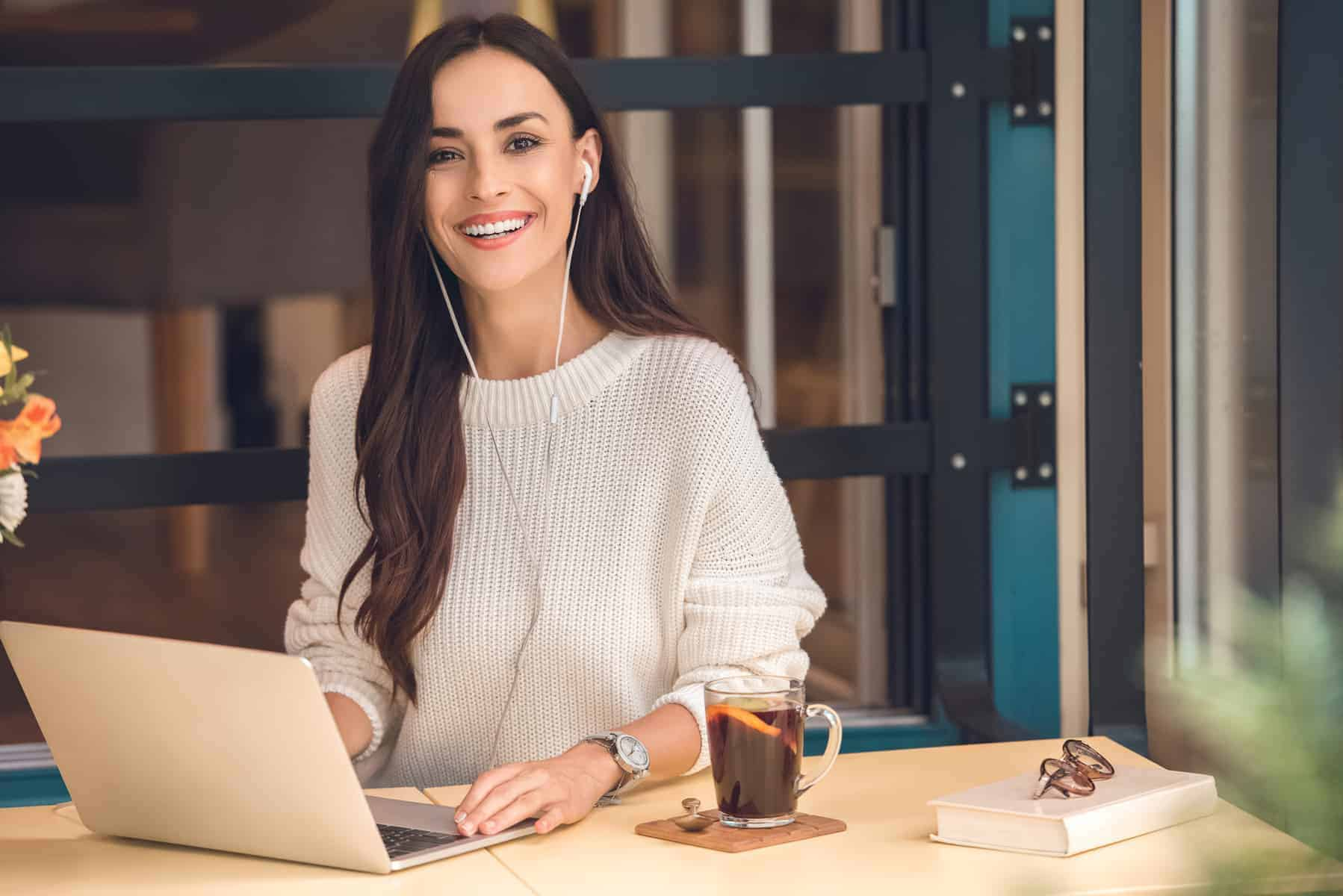 brunette young woman on laptop smiling
